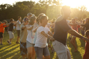 Family dance night with the sun during the golden hour